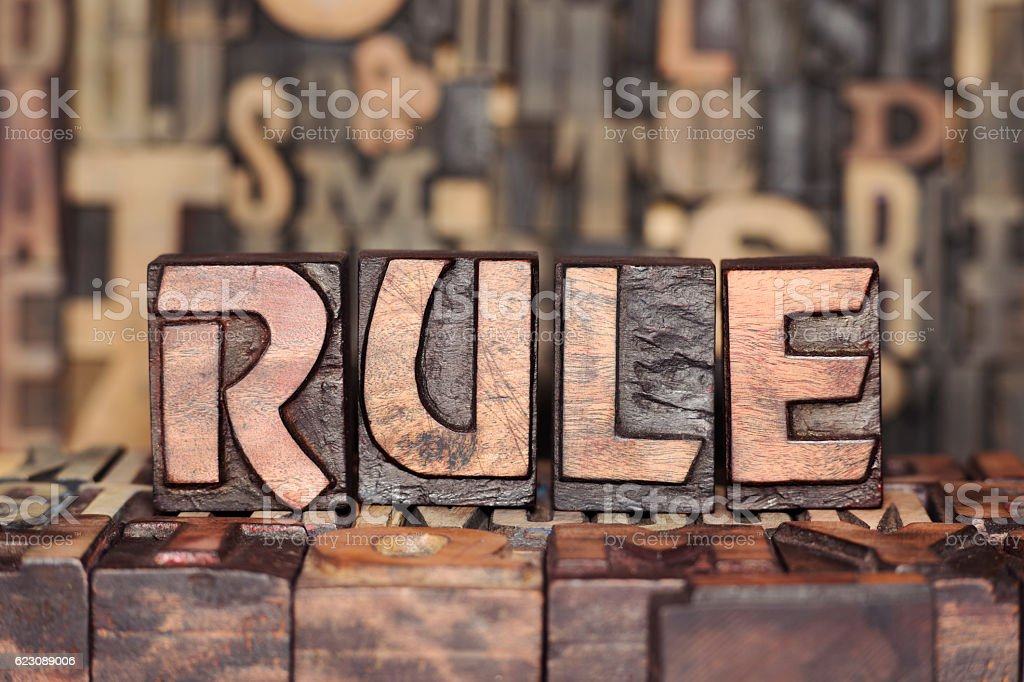 wooden RULE concept stock photo