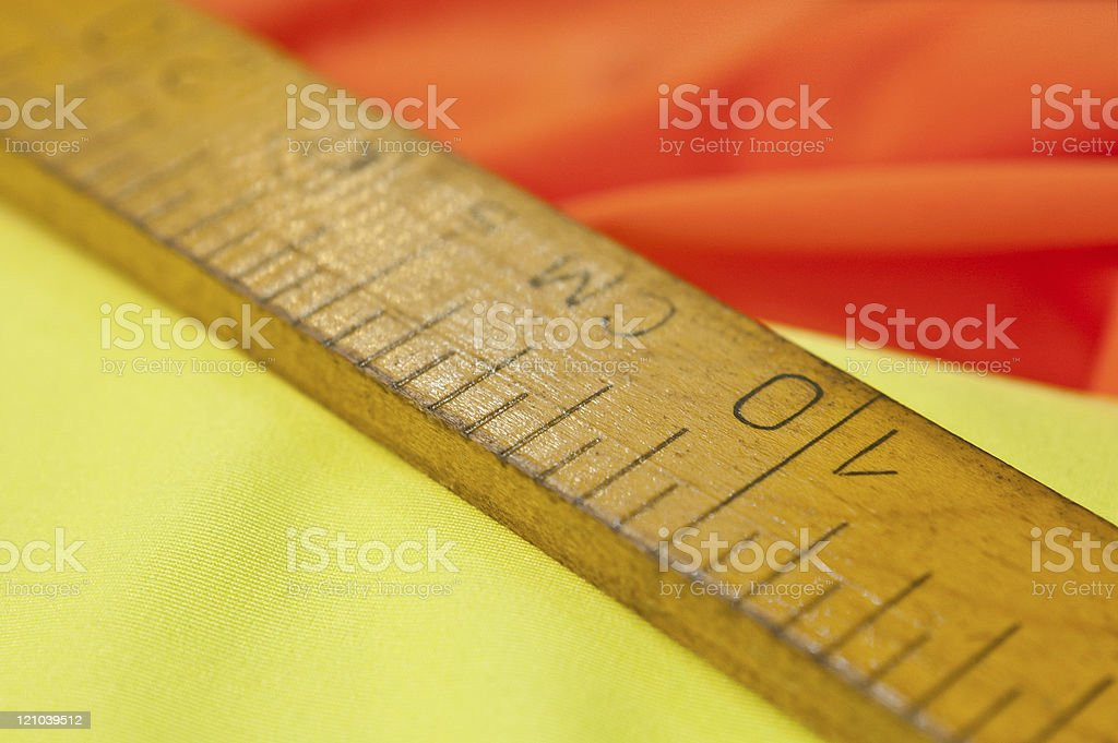 Wooden ruler for fabric stock photo