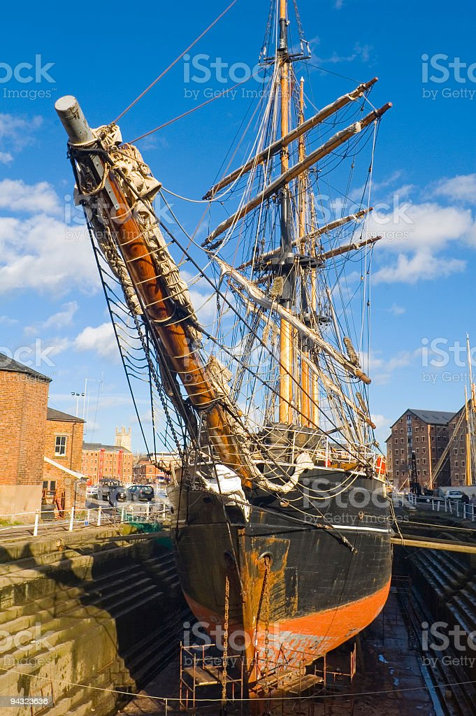 Wooden sailing ship being repaired stock photo