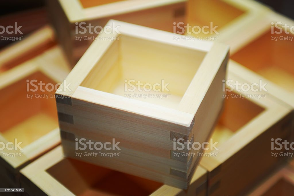 Wooden Sake cups stacked together and photographed close up stock photo
