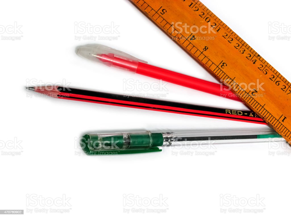 wooden scale,red pencil and green & red pen stock photo