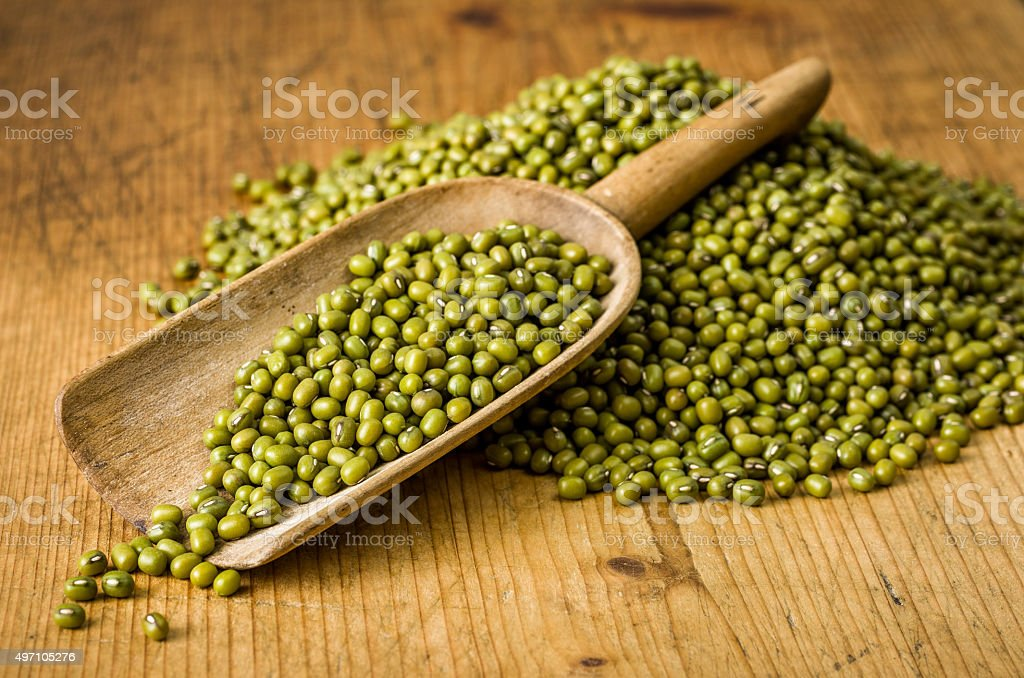 Wooden scoop with mung beans stock photo