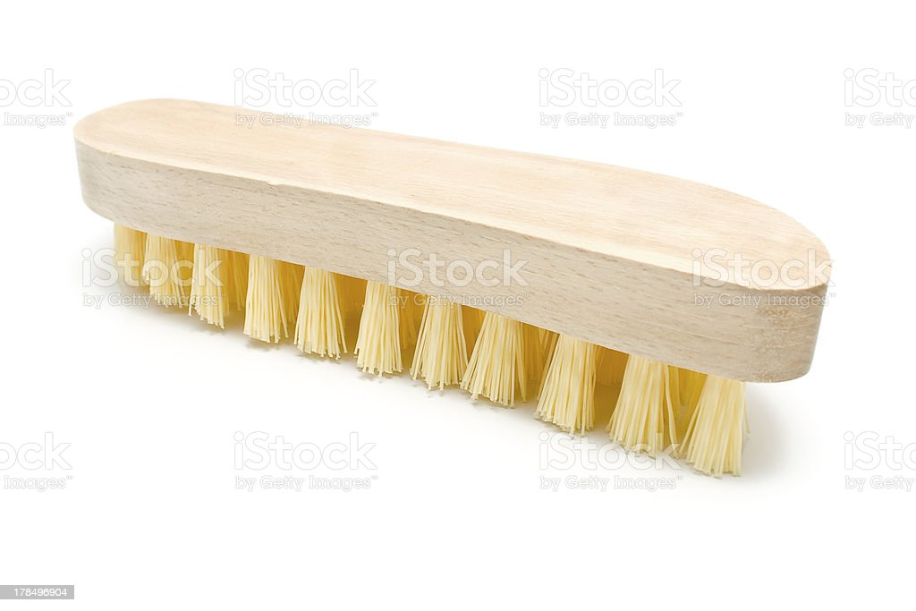 Wooden scrub brush with yellow bristles royalty-free stock photo