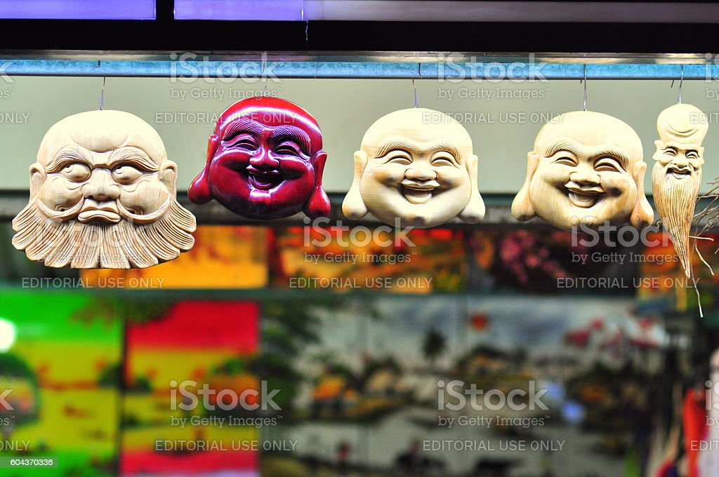 Wooden sculpture of Maitreya Buddha faces are for sale stock photo