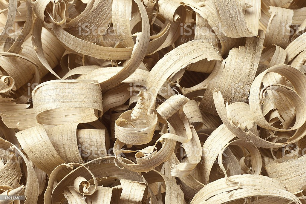 Wooden shavings in workshop on planks royalty-free stock photo