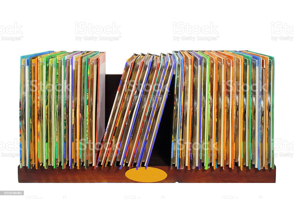 wooden shelf with colorful cd dvd disks isolated on white stock photo