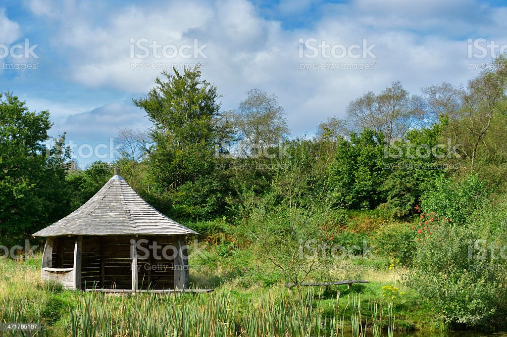 Wooden shelter in rural scene on a bright sunny day stock photo