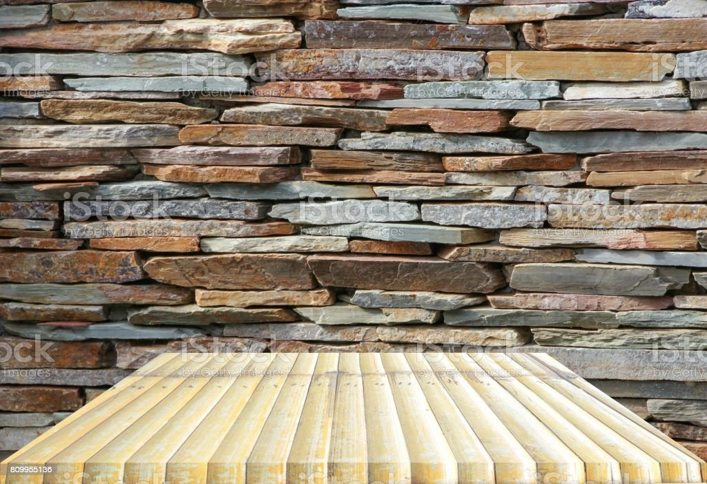 wooden shelves top empty and floor ceiling in stone wall background...