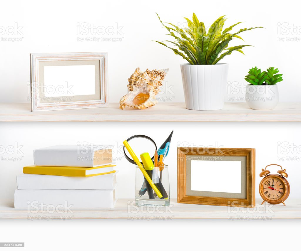 Wooden shelves with different office related objects stock photo