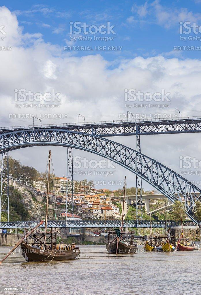 Wooden ships and steel bridge in Porto stock photo