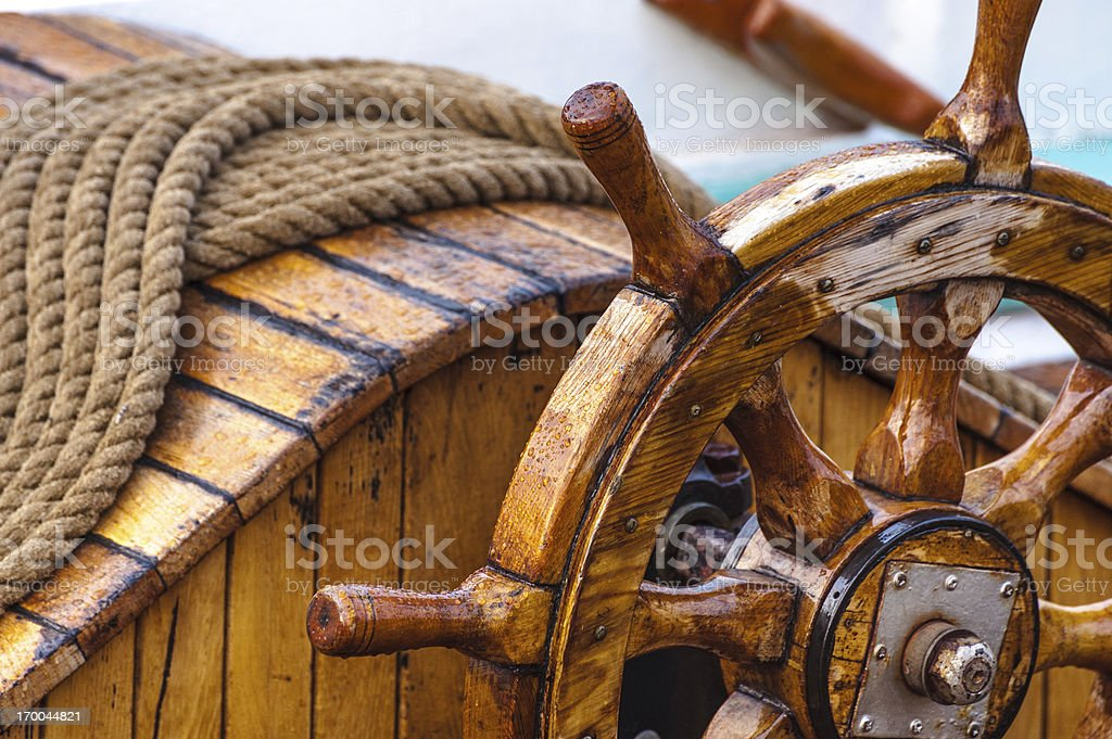 Wooden ship's wheel stock photo