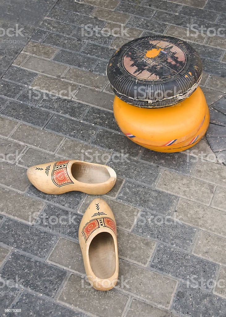 Wooden shoes and gouda cheese stock photo