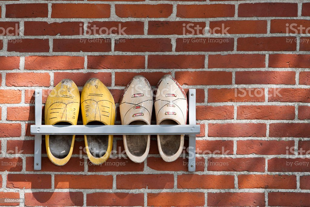 Wooden shoes hanging outdoor on a wall stock photo
