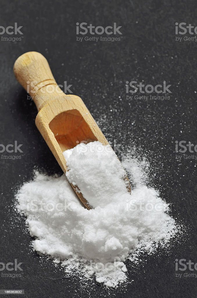Wooden shovel with sodium bicarbonate stock photo