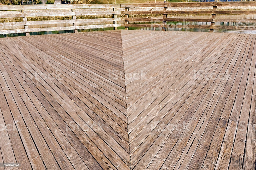 wooden sidewalk in a park royalty-free stock photo