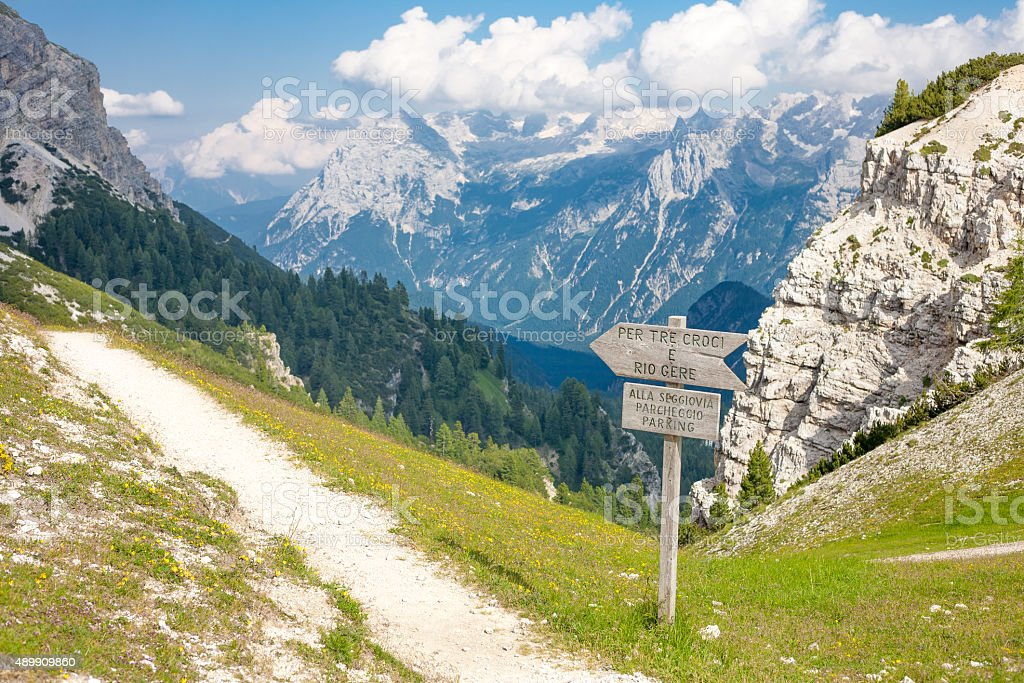 Wooden sign in the Dolomites stock photo