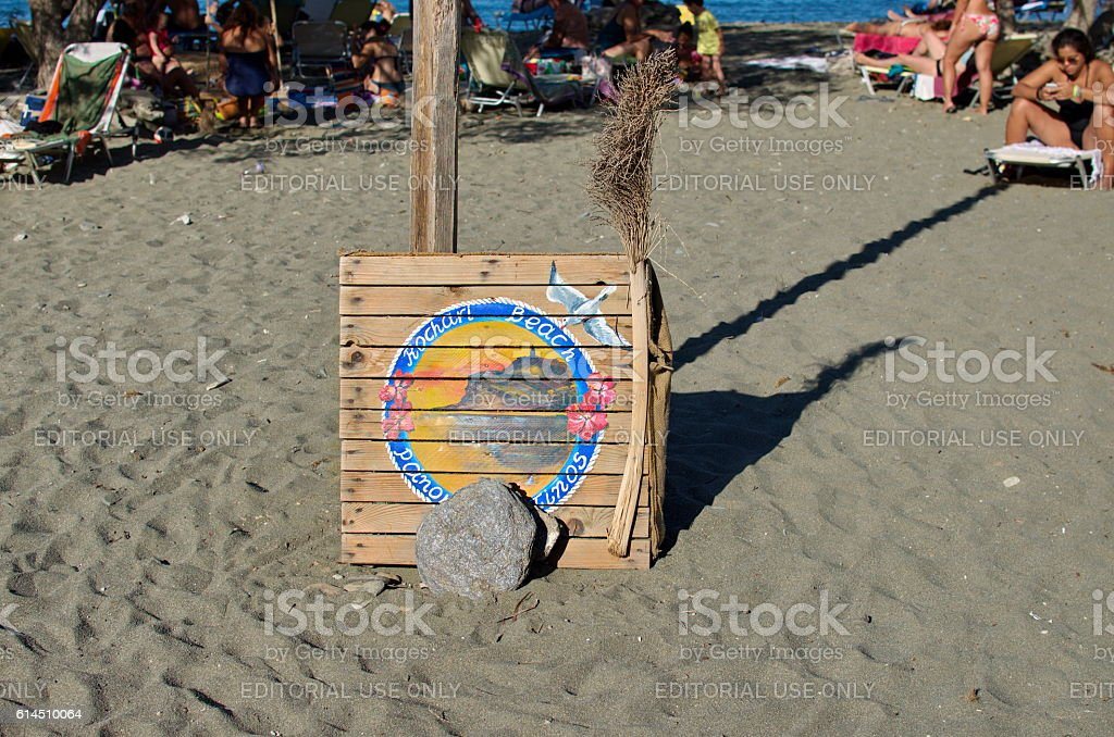 Wooden sign of Rohari Beach in Tinos Island stock photo