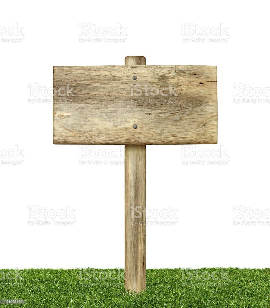 Wooden sign on grass isolated stock photo