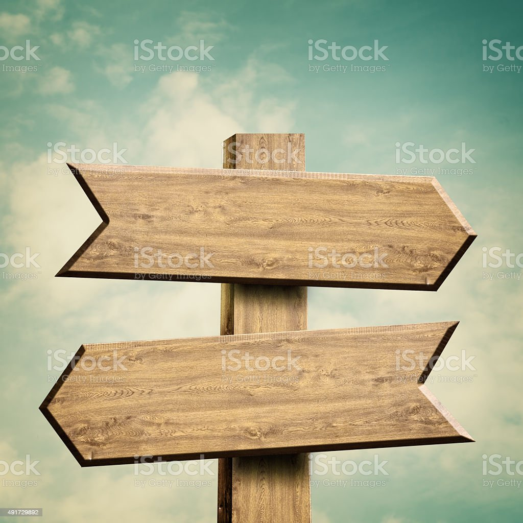Wooden sign over abstract natural backgrounds stock photo