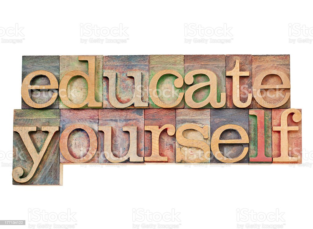 Wooden sign that read educate yourself royalty-free stock photo