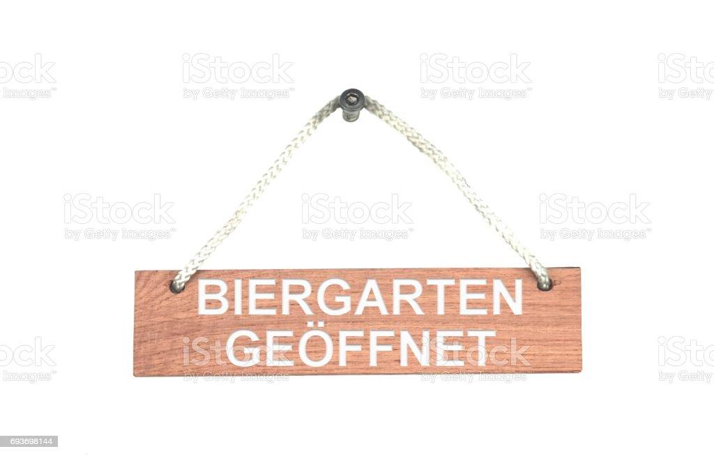 Wooden sign with rope: Open Beer Garden german stock photo
