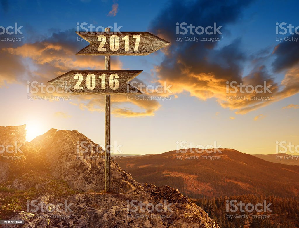 Wooden sign with text 2016 and 2017 stock photo