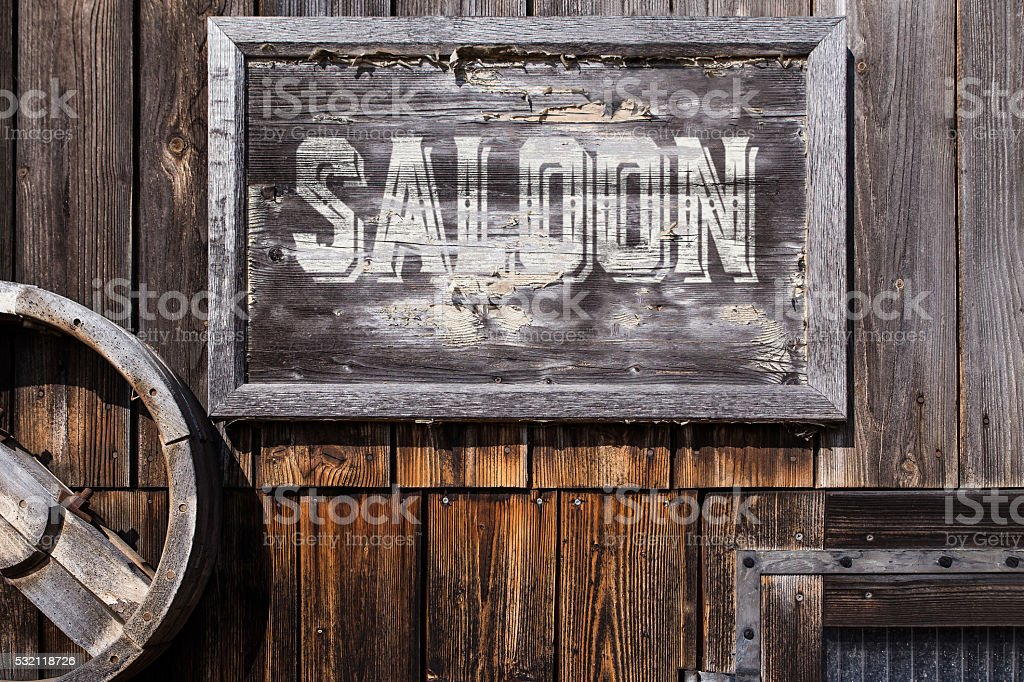 wooden sign with word saloon stock photo