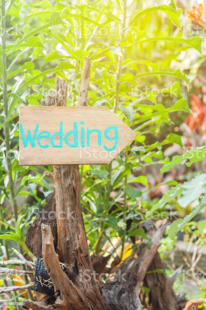 Wooden signboard with the inscription in  paint wedding. Wood hand made wedding decoration table. stock photo