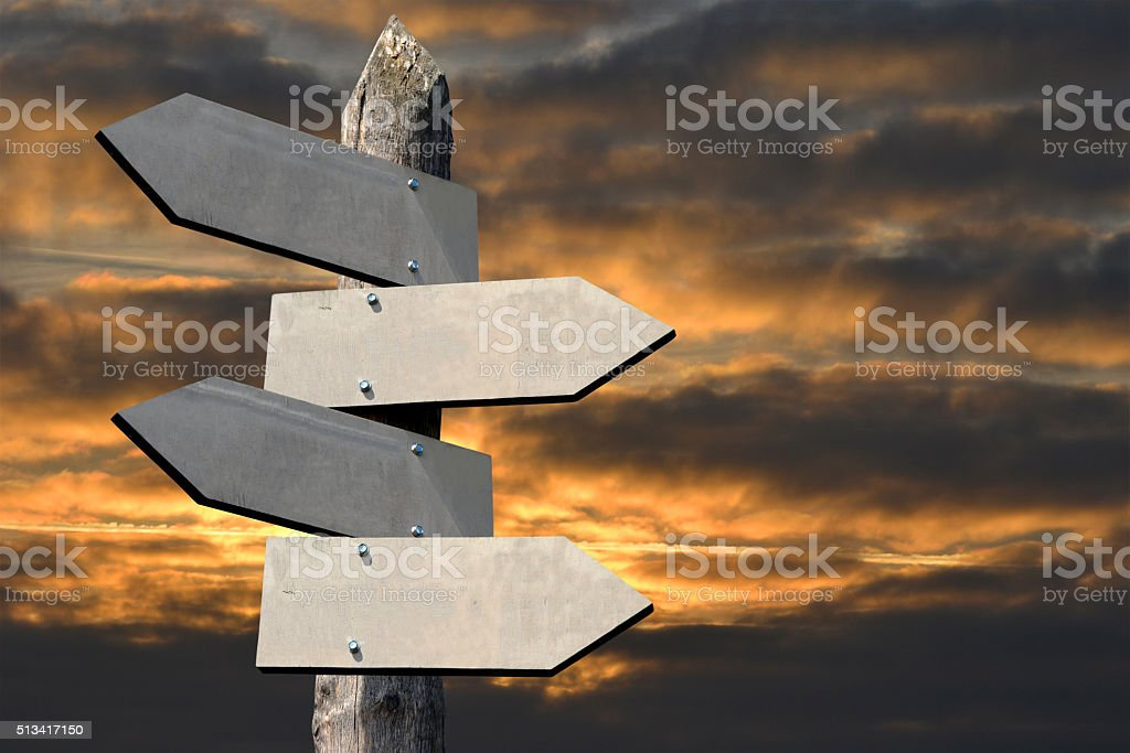 Wooden signpost - crossroads stock photo