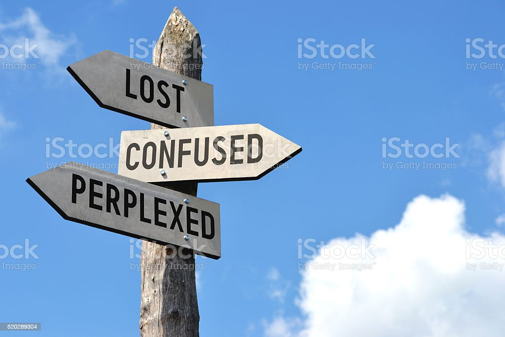 Wooden signpost - lost, confused, preplexed stock photo