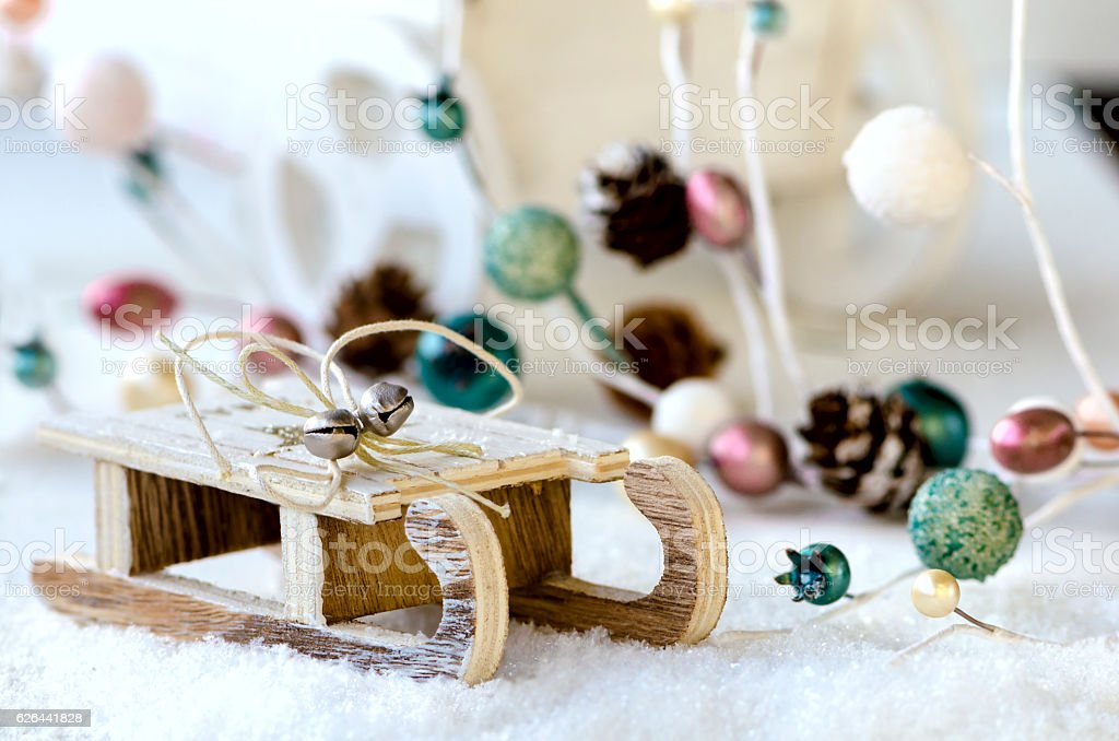 Wooden sled with Christmas and New Year garland and snow stock photo