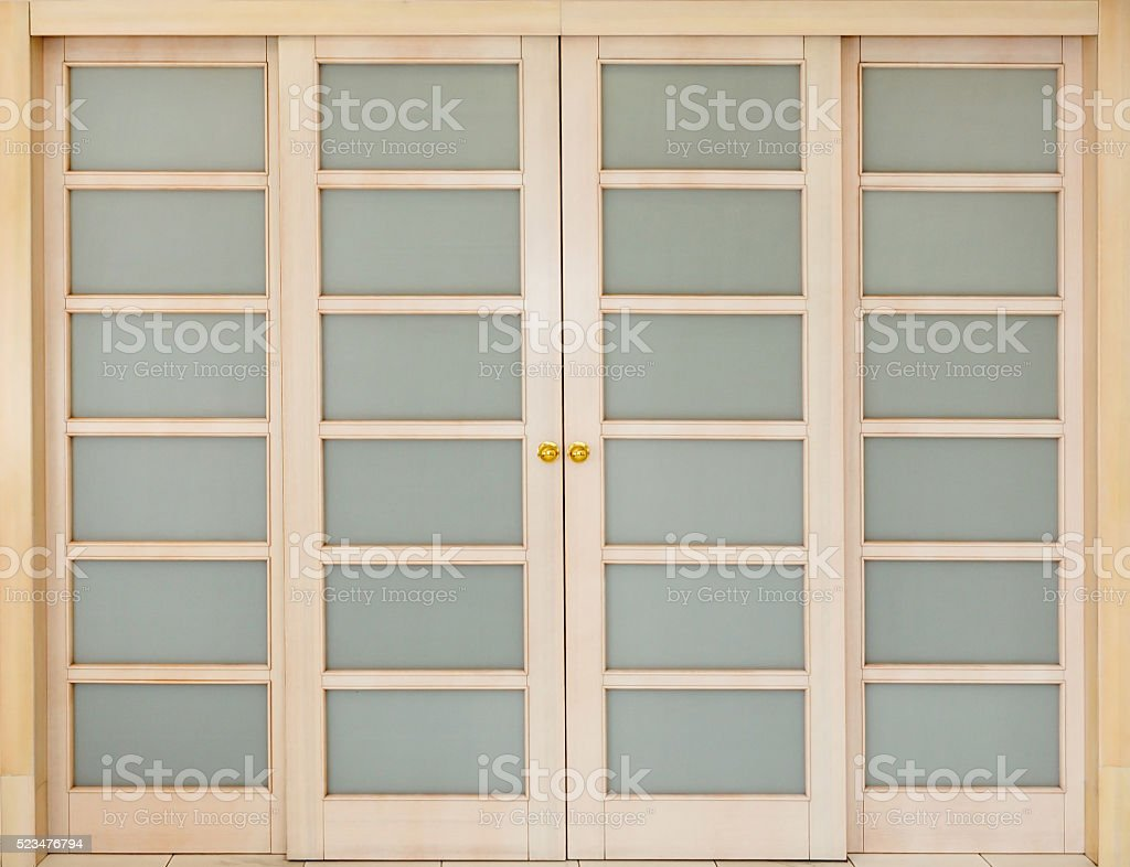 wooden sliding door with glass inserts. stock photo