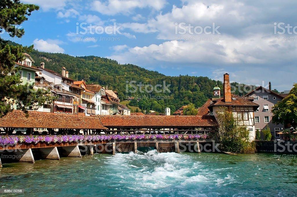 wooden sluice bridge in Thun stock photo