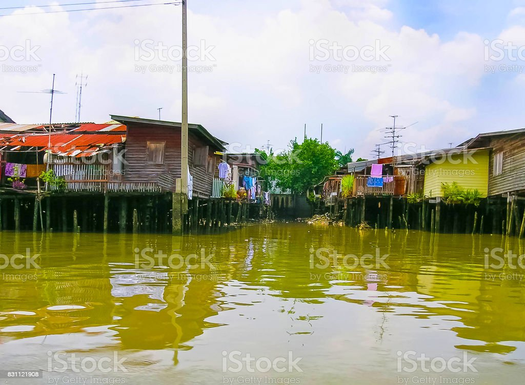 Wooden slums on stilts the riverside of Chao Praya River in Bangkok, Thailand stock photo