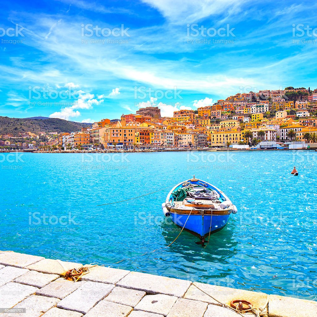 Wooden small boat in Porto Santo Stefano seafront. Argentario, T stock photo
