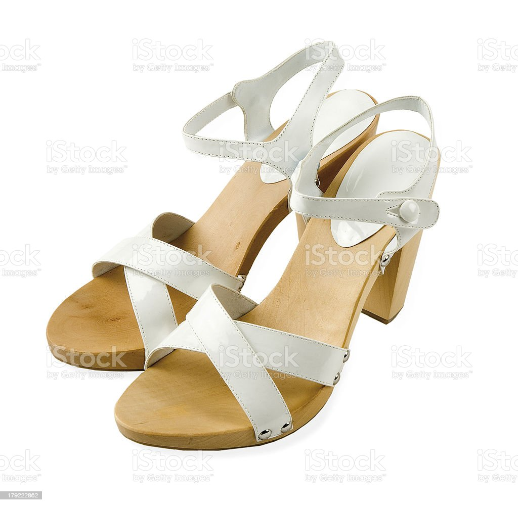 Wooden soled white leather high heeled elegant sandals stock photo