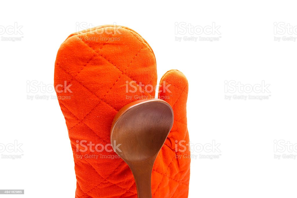 Wooden Soup Spoon with Red Potholder Glove stock photo