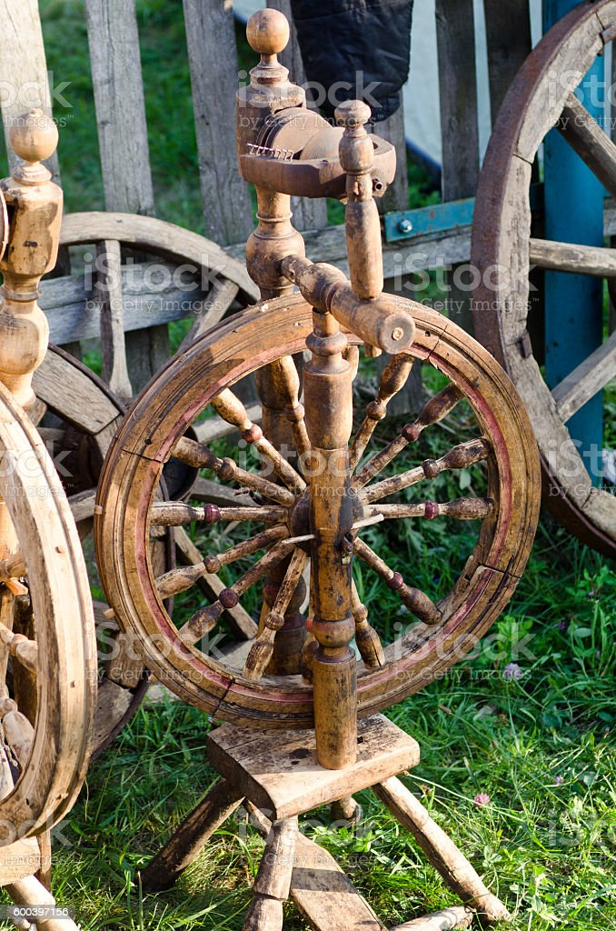 wooden spinning wheel stock photo