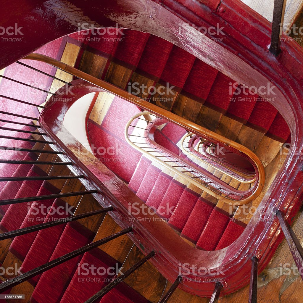 wooden spiral steps in old house stock photo
