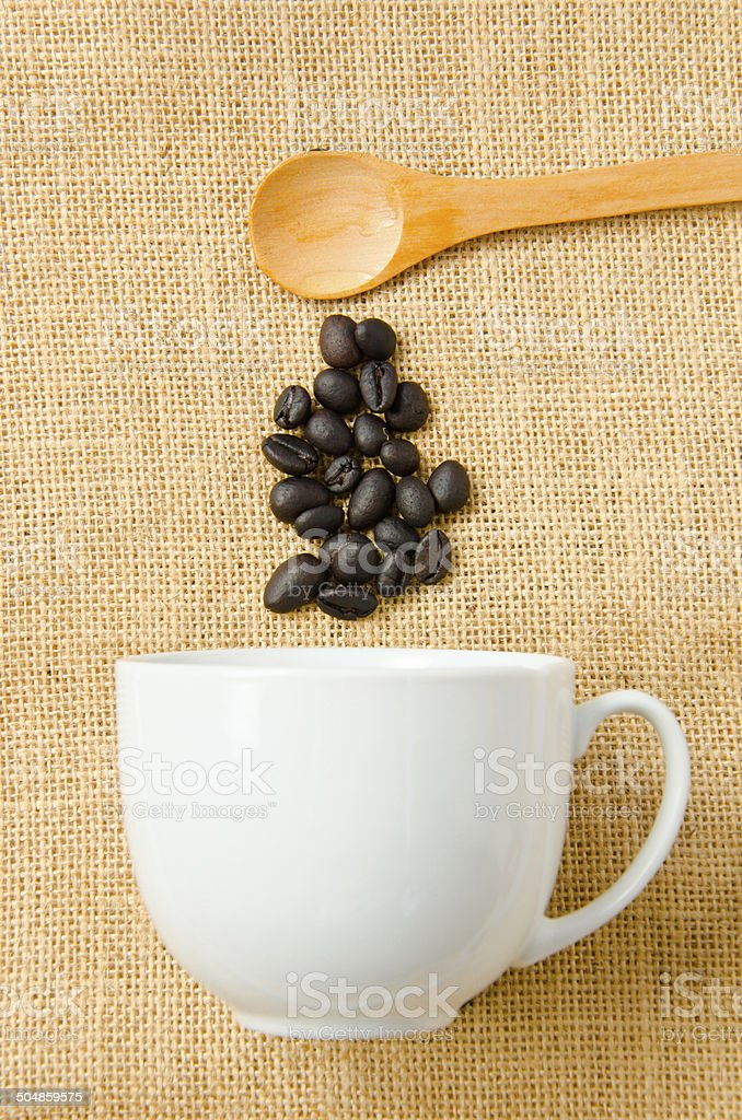 Wooden spoon and a cup of coffee royalty-free stock photo