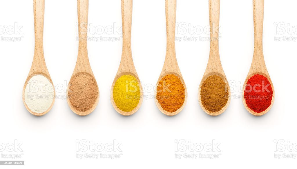 Wooden Spoon filled with colorful spices stock photo