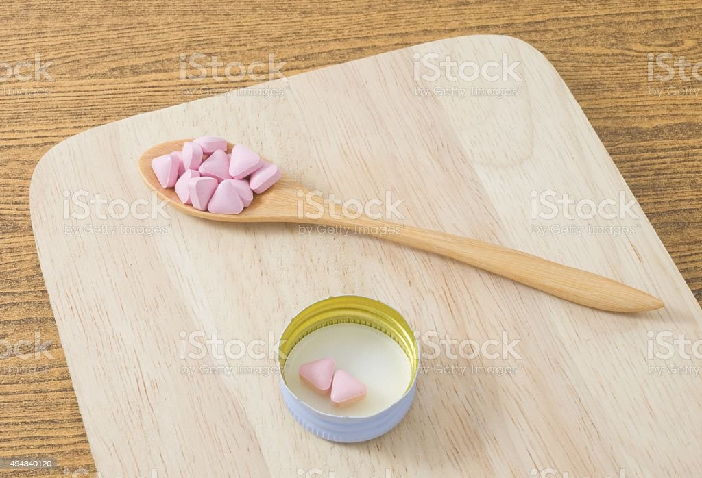 Wooden Spoon Full of Vitamins on A Tray stock photo