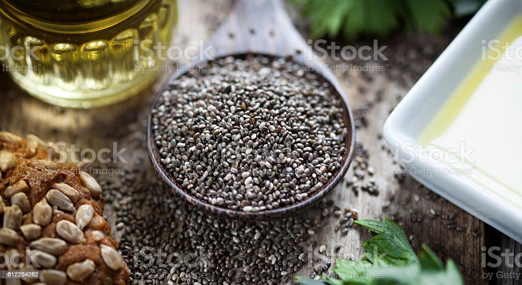 Wooden spoon oil chia seeds bread stock photo