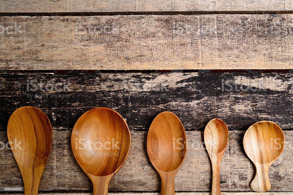 wooden spoon on desk stock photo