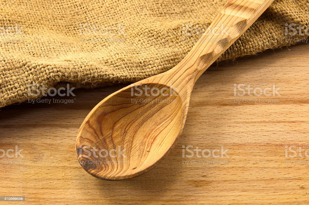Wooden spoon on the board stock photo