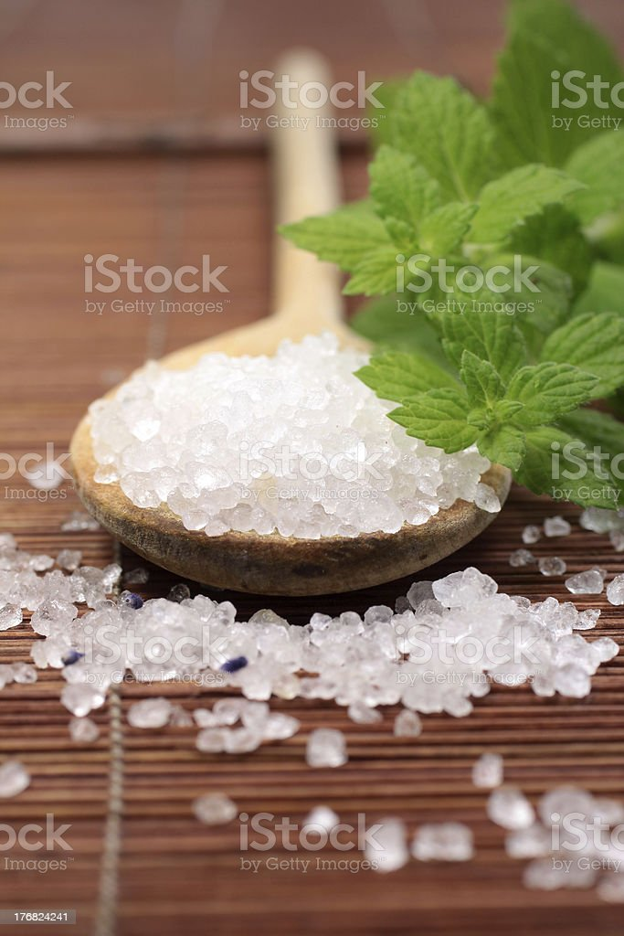 wooden spoon with bath salt stock photo