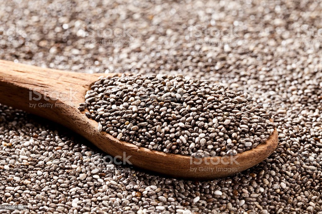 Wooden spoon with chia seeds stock photo