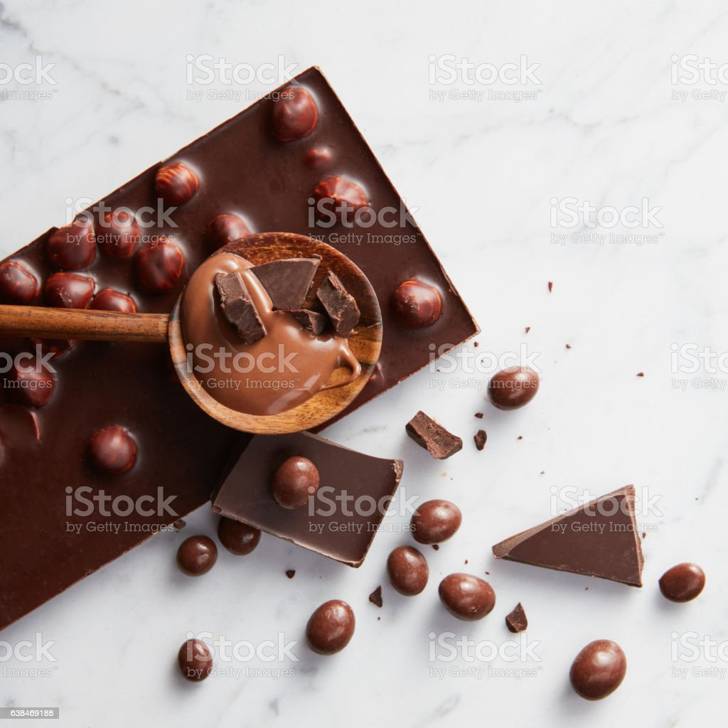 wooden spoon with chocolate stock photo