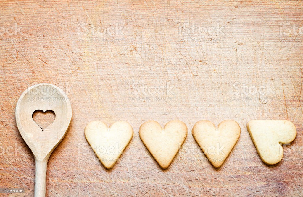 Wooden spoon with cookies baking abstract background stock photo