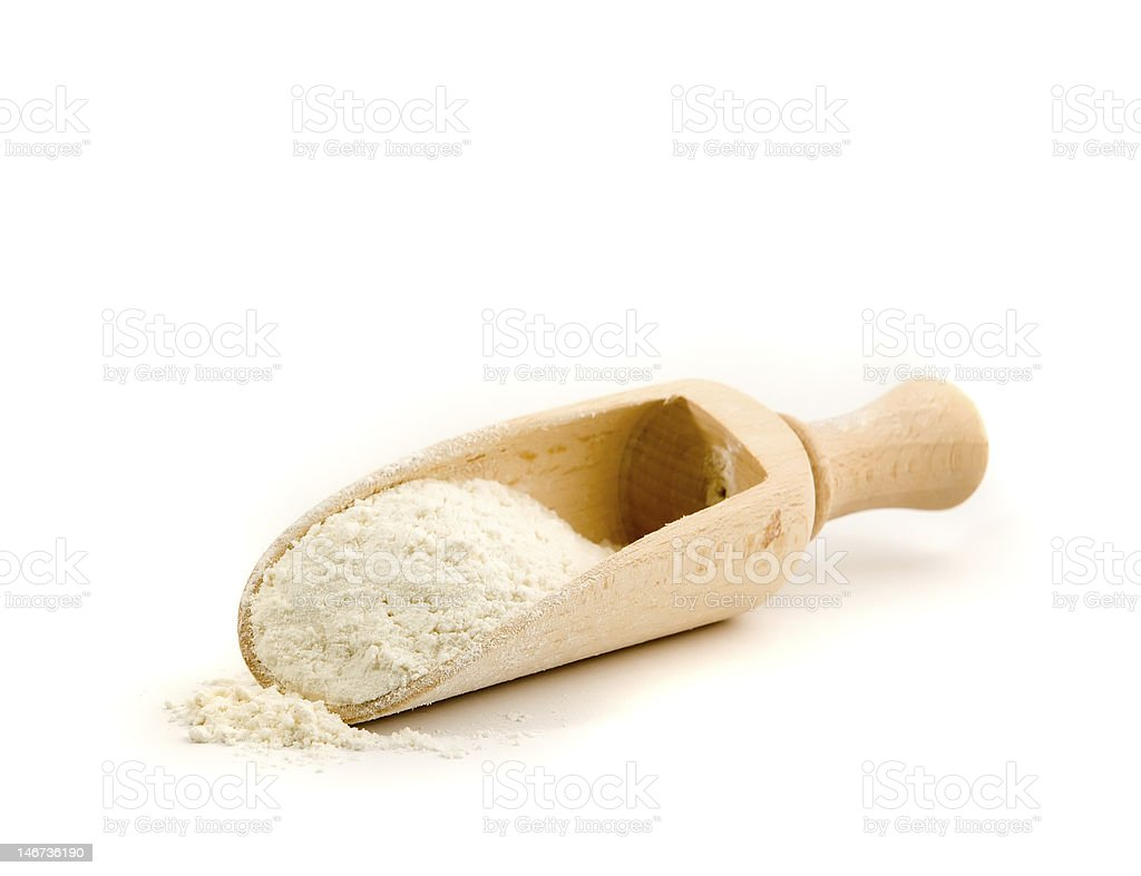 Wooden spoon with flour stock photo